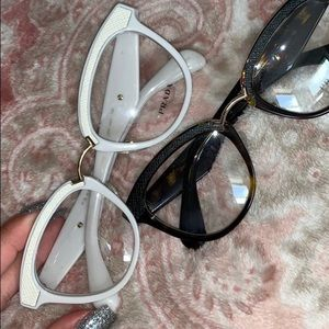 White Prada glasses with leather accents
